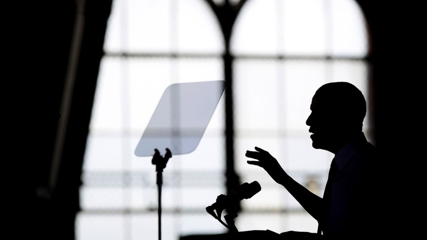ANN ARBOR, MI - APRIL 2: U.S. President Barack Obama is silhouetted as he speaks about his proposal to raise the federal minimum wage at the University of Michigan on April 2, 2014 in Ann Arbor, Michigan. Obama said every American deserves a fair working wage.(Photo by Joshua Lott/Getty Images)
