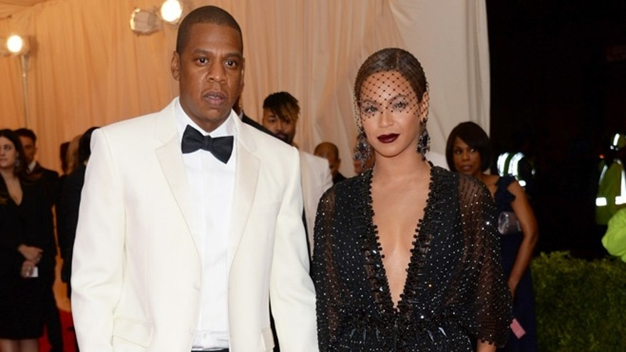 "FILE - This May 5, 2014 file photo shows Jay Z, left, and Beyonce at The Metropolitan Museum of Art's Costume Institute benefit gala celebrating ""Charles James: Beyond Fashion"" in New York. (Photo by Evan Agostini/Invision/AP, File)"