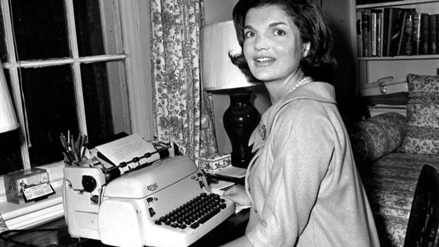 This photo shows Jackie Kennedy at her typewriter in 1960 (AP)