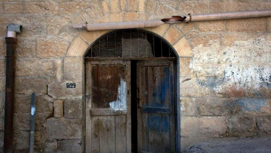 In this photo taken Sunday, May 18, 2014, the entrance of an abandoned house that belongs to a Palestinian Christian emigre family.