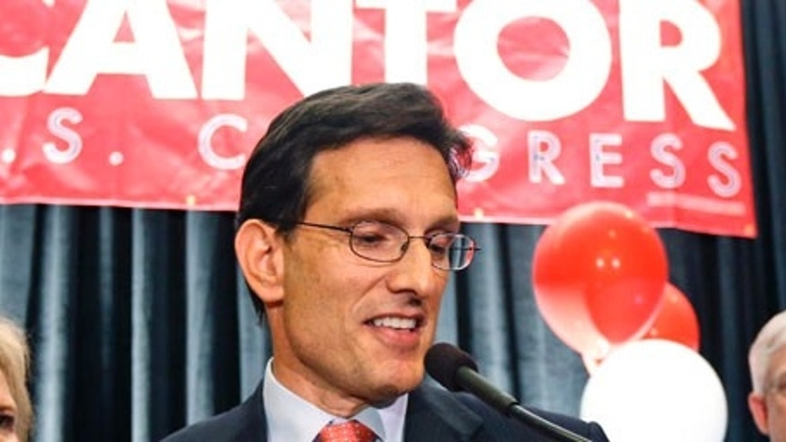 Congressman Eric Cantor, R-Va.,  stands beside his wife Diana, left,  and delivers a concession speech at his election night party in Richmond, Va., Tuesday, June 10, 2014. Cantor lost the GOP primary to tea party candidate Dave Brat.  (AP Photo/Steve Helber)