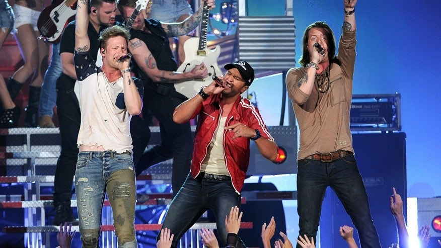Luke Bryan, center, and from left, Brian Kelley and Tyler Hubbard, of the musical group Florida Georgia Line, perform at the Billboard Music Awards at the MGM Grand Garden Arena on Sunday, May 18, 2014, in Las Vegas.