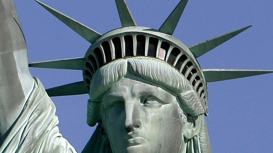 May 20, 2009: The Statue of Liberty against the deep blue sky in New York Harbor. On Friday, Oct. 28, 2011 the statue will host the 125th anniversary of its dedication with a Naturalization Ceremony, the presentation of a gift to continue its preservation and an evening fireworks display.