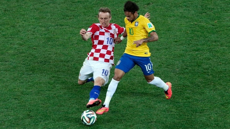 Croatia's Luka Modric, left, and Brazil's Neymar challenge for the ball during the group A World Cup soccer match between Brazil and Croatia, the opening game of the tournament, in the Itaquerao Stadium in Sao Paulo, Brazil, Thursday, June 12, 2014.