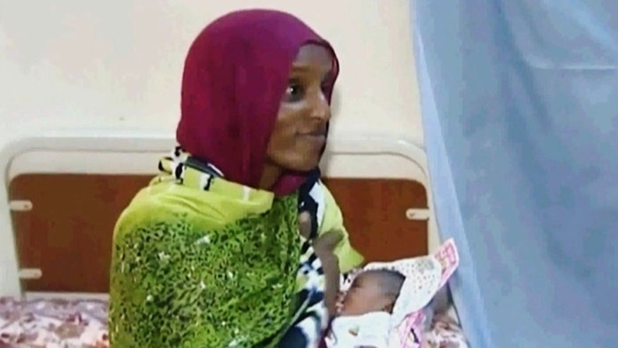 June 5, 2014: In this file image made from an undated video provided by Al Fajer, a Sudanese nongovernmental organization, Meriam Ibrahim breastfeeds her newborn baby girl as the NGO visits her in a room at a prison in Khartoum, Sudan.
