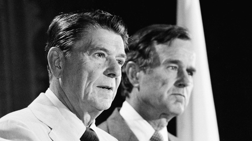 July 26, 1980: Republican presidential candidate Ronald Reagan and running mate George Bush answer questions during a press conference.