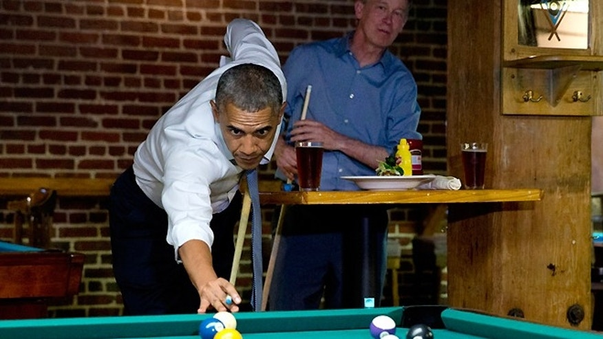 July 8, 2014: President Obama plays pool in Denver at Wynkoop Brewing Co. with Colorado Gov. John Hickenlooper.