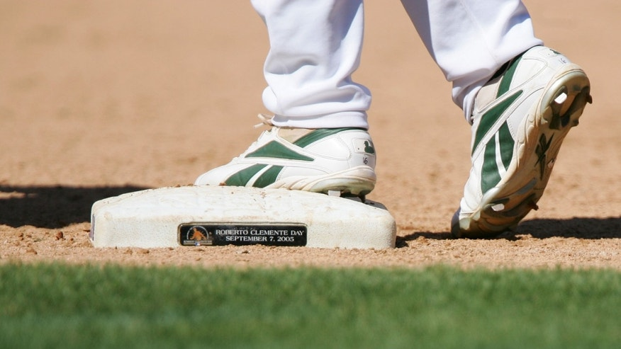 OAKLAND, CA - SEPTEMBER 7:  A detail of a base commemorating Roberto Clemente is seen during the Oakland Athletics game against the Seattle Mariners at McAfee Coliseum on September 7, 2005 in Oakland, California. The A's defeated the Mariners 8-7.  (Photo by Jed Jacobsohn/Getty Images)