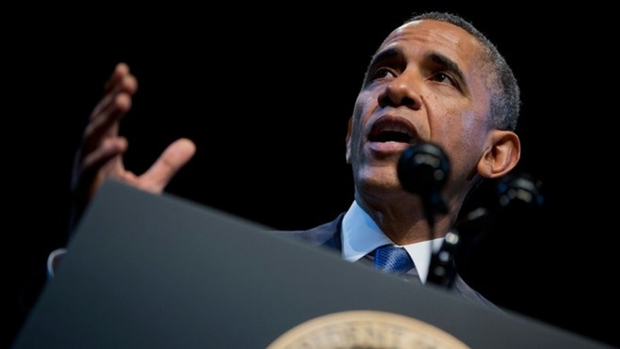 "FILE - Dec. 4, 2013: President Obama speaks about the economy and growing economic inequality, at the Town Hall Education Arts Recreation Campus in Washington. The president said the income gap between America's rich and poor is a ""defining challenge of our time."""
