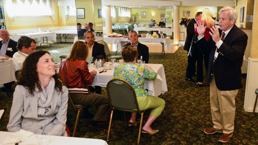 July 8, 2014: Scott Kane, managing director of Gray Hair Management, leads a breakfast networking session at a restaurant in Elk Grove Village, Ill.
