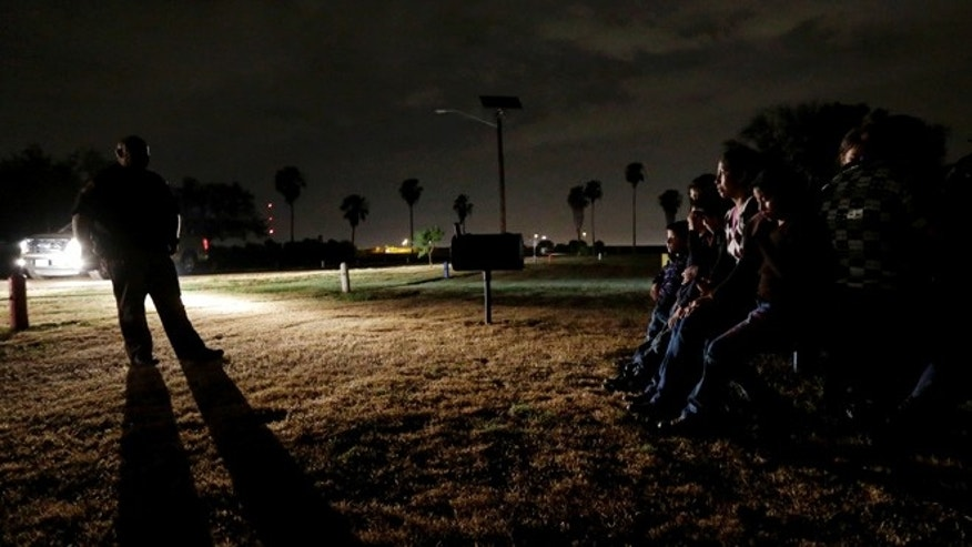 June 25, 2014: A group of immigrants from Honduras and El Salvador, who crossed the U.S.-Mexico border illegally, are stopped in Granjeno, Texas.