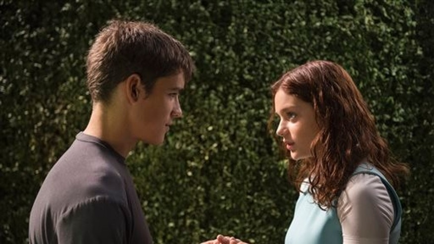"This photo released by The Weinstein Company shows Brenton Thwaites, left, and Odeya Rush in a scene from the film, ""The Giver."" (AP Photo/The Weinstein Company, David Bloomer)"