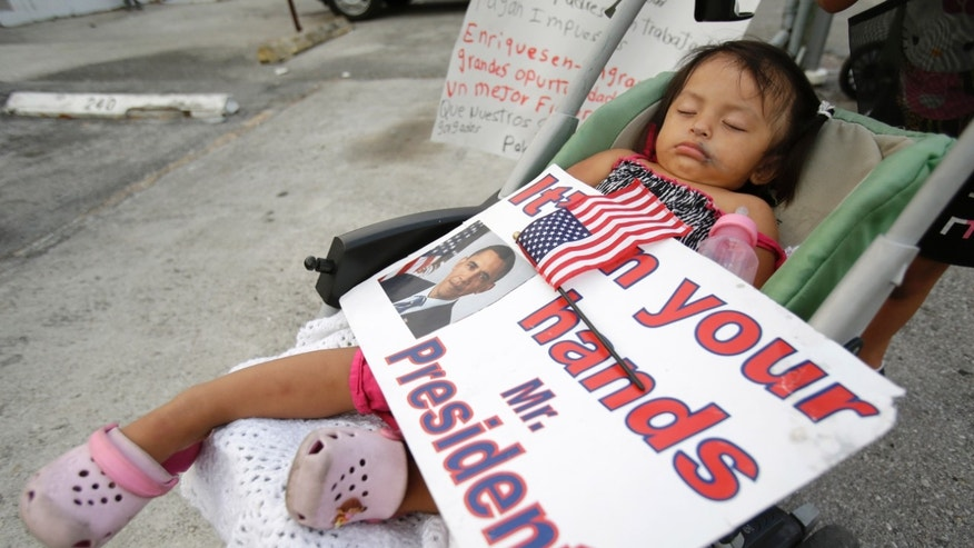 Diana Jimenez, 2, sleeping through a rally in Homestead, Fla., on April 30, 2014.