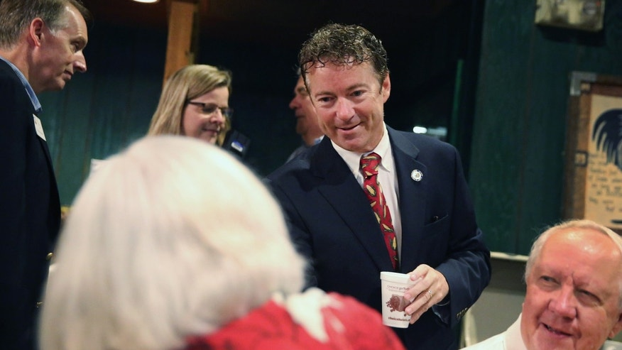 URBANDALE, IA - AUGUST 06:  U.S. Rand Paul (R-KY) (C) greets guest during a breakfast hosted by the Westside Conservative Club at the Machine Shed Restaurant on August 6, 2014 in Urbandale, Iowa.  Paul, who is expected to seek the 2016 Republican presidential nomination, was on a three-day, eight-city tour of Iowa, the first state in the nation to select the presidential nominee.  (Photo by Scott Olson/Getty Images)