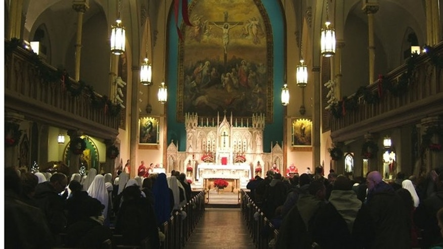 Mass is celebrated at the Church of the Holy Innocents in New York City. (Courtesy Vijay Wijesundera)