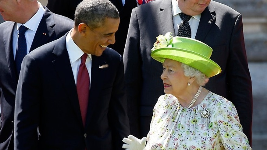 June 6, 2014: President Obama talks with Britain's Queen Elizabeth during a family photo for the 70th anniversary of the D-Day landings in Benouville, France.