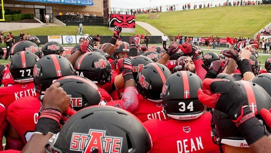 Memorial decals seen on the helmets of the Arkansas State team before a game with Montana State earlier this year.