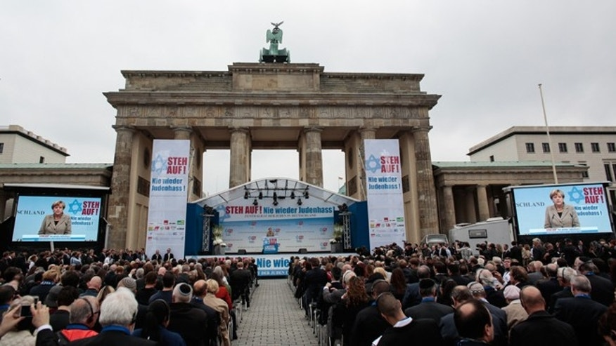 Sept. 14, 2014: German Chancellor Angela Merkel delivers her speech at a rally against anti-Semitism near the Brandenburg Gate in Berlin. Thousands of protesters attended the public rally organized by Germany's Jewish community at the capital's Brandenburg Gate after tensions over the Gaza conflict spilled over into demonstrations in Europe that saw anti-Jewish slogans and violence. The slogan reads: Stand Up! - Jew hatred - never again!', and the name of the organizer: Central Council of Jews in Germany.