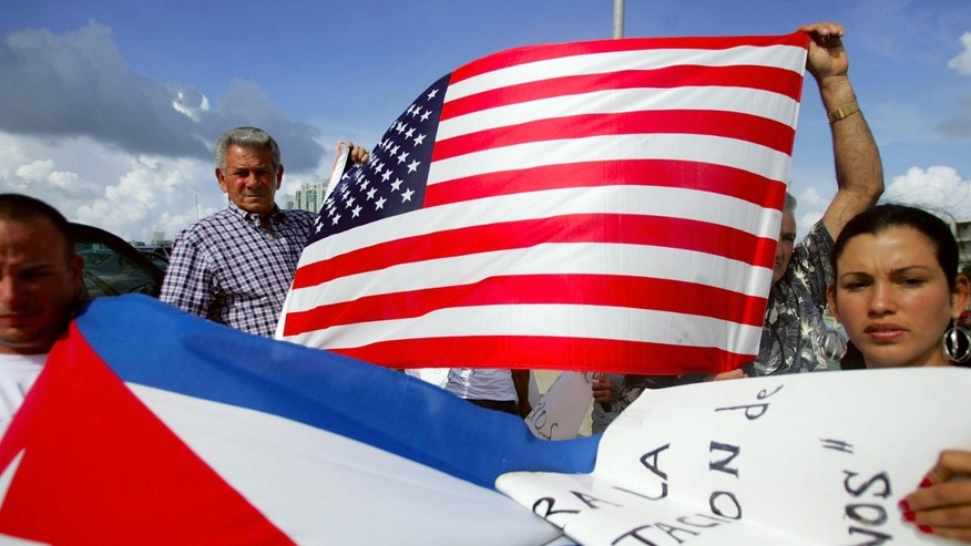 MIAMI - JULY 11:  Oridio Conde (L) and Laura Hernandez participate in a protest July 11, 2006 in Miami, Florida. The protest was being held by relatives and friends of the Cubans involved in this past weekend?s interdiction at sea by the U.S. Coast Guard. They want the U.S. government to allow their relatives who are being held on a Coast Guard cutter to be allowed into the United States. One person died and four others were injured when their boat ignored orders to stop by the Coast Guard.  (Photo by Joe Raedle/Getty Images)