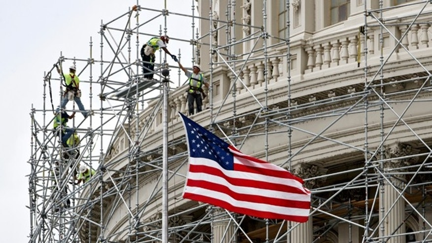 Oct. 2, 2014: Workmen continue to gird the Capitol Dome in scaffolding for a long-term repair project to fix cracks, leaks and corrosion in the cast-iron structure. The $60 million job will take up to four years with the scaffolding eventually surrounding the dome.