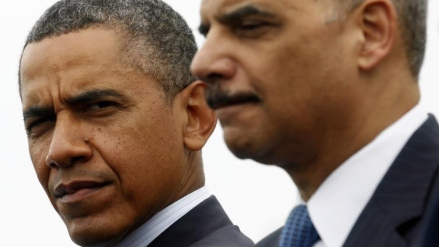 President Obama and the recently resigned Attorney General Eric Holder.