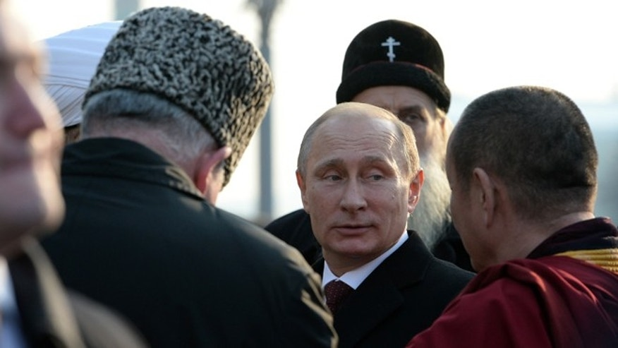 Nov. 4, 2014: Russian President Vladimir Putin, center, speaks with the confessional leaders during a ceremony at the Red Square in Moscow on  National Unity Day, a national holiday which this year marks the 402th anniversary of the 1612 expulsion of Polish occupiers from the Kremlin.