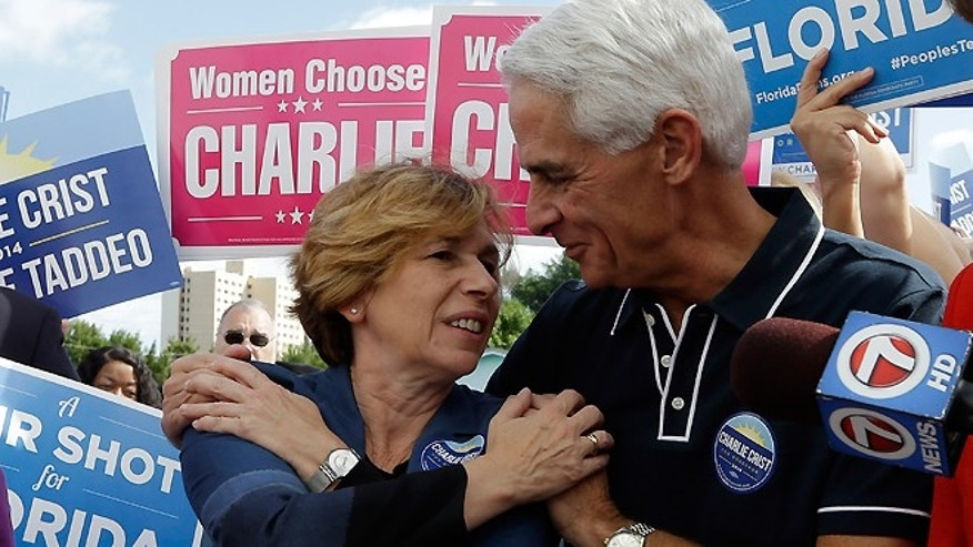 Nov. 3, 2014: Democratic gubernatorial candidate Charlie Crist, right, talks with Randi Weingarten, president of the American Federation of Teachers, left, as he campaigns at the International Brotherhood of Electrical Workers Hall, in Miami.