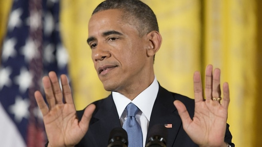 Nov. 5, 2014: President Obama gestures as he speaks during a news conference in the East Room of the White House in Washington.