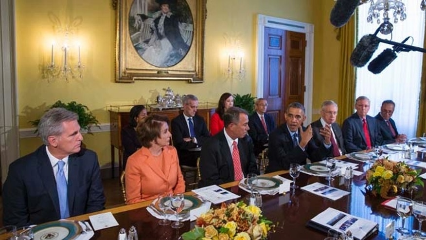 In this Friday, Nov. 7, 2014 photo President Barack Obama meets with Congressional leaders in the Old Family Dining Room of the White House in Washington.