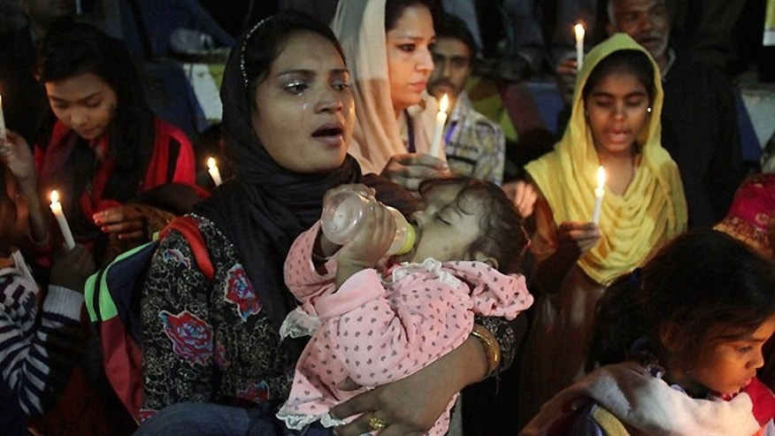 Nov. 12, 2014: Pakistani Christians hold candles to pay tribute to a slain Christian couple in Lahore, Pakistan. Police in Pakistan said they have arrested as many as 45 Muslims in connection with the killing of the Christian couple for allegedly desecrating the Koran. Under Pakistan's harsh blasphemy laws, anyone convicted of insulting Islam or the Prophet Muhammad can be sentenced to death. However, the laws are often misused to settle personal scores and target minorities.