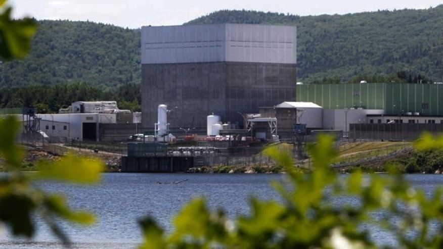 FILE -- June 19, 2013 photo, the Vermont Yankee Nuclear Power Station sits along the banks of the Connecticut River in Vernon, Vt. Entergy Corp., announced Tuesday, Aug. 27, 2013, it will shut down the nuclear power plant by end of 2014, ending a long legal battle with the state.