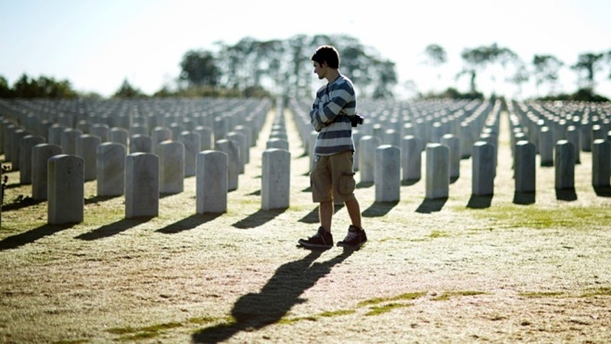 Nov. 11, 2014: A visitor at the South Florida National Cemetery walks among veterans' graves on Veterans Day in Lake Worth, Fla.