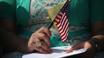 JERSEY CITY, NJ - SEPTEMBER 19:  Immigrants prepare to become U.S. citizens at a naturalization ceremony at Liberty State Park on September 19, 2014 in Jersey City, New Jersey. Forty immigrants from 18 different countries became American citizens at the event, held by U.S. Citizenship and Immigration Services (USCIS), on Constitution and Citizenship Day. This week USCIS will have naturalized more than 27,000 new citizens at 160 ceremonies nationwide.  (Photo by John Moore/Getty Images)