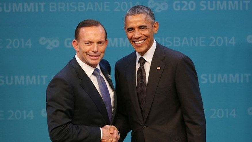 Nov. 15, 2014: Prime Minister of Australia Tony Abbott welcomes  President Obama to the G-20 summit in Brisbane, Australia.