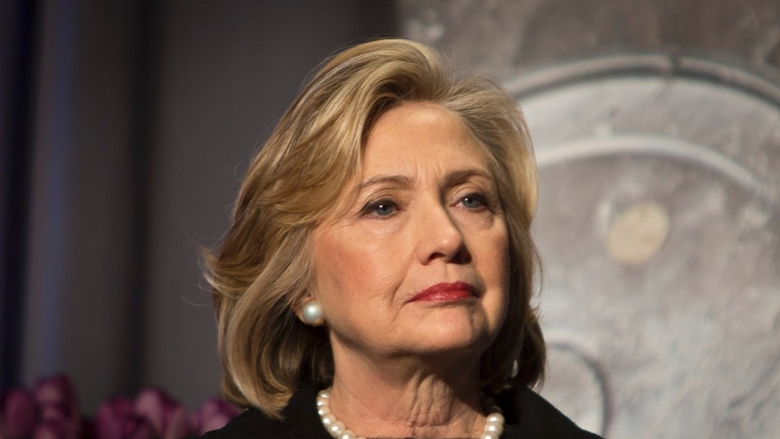 Hillary Rodham Clinton, former US Secretary of State, listens before delivering keynote remarks at the Global Alliance for Clean Cookstoves summit, Friday Nov. 21, 2014 in New York.  (AP Photo/Bebeto Matthews)