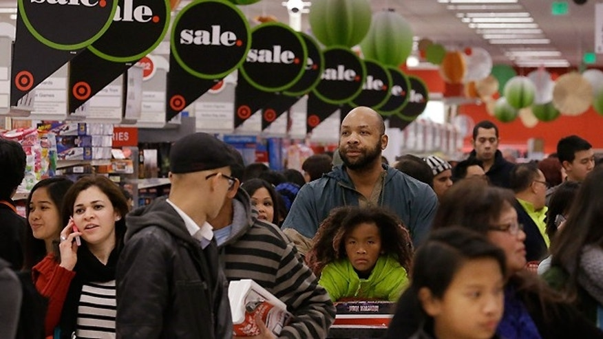 FILE - In this Nov. 28, 2013 file photo, customers shop at a Target store in Colma, Calif.