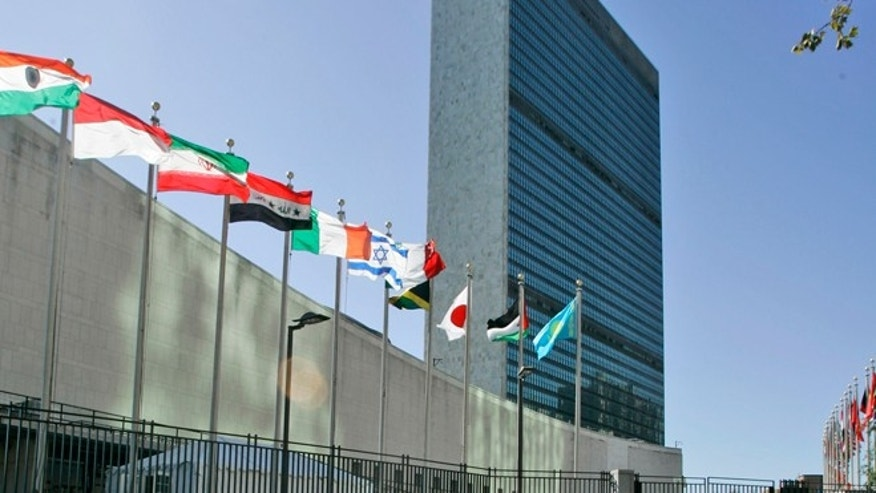FILE -- Sept. 18, 2007: The flags of member nations fly outside of the United Nations headquarters in New York.