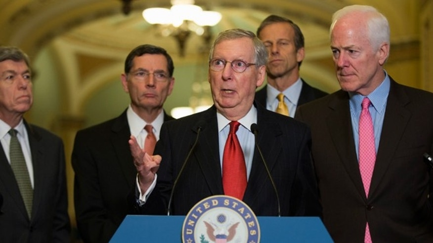 Dec. 2, 2014: Senate Minority Leader Mitch McConnell of Ky., center, gestures during a news conference on Capitol Hill in Washington. From left are, Sen. Roy Blunt, R-Mo., Sen. John Barrasso, R-Wyo., McConnell, Sen. John Thune, R-S.D., and Senate Minority Whip John Cornyn of Texas.