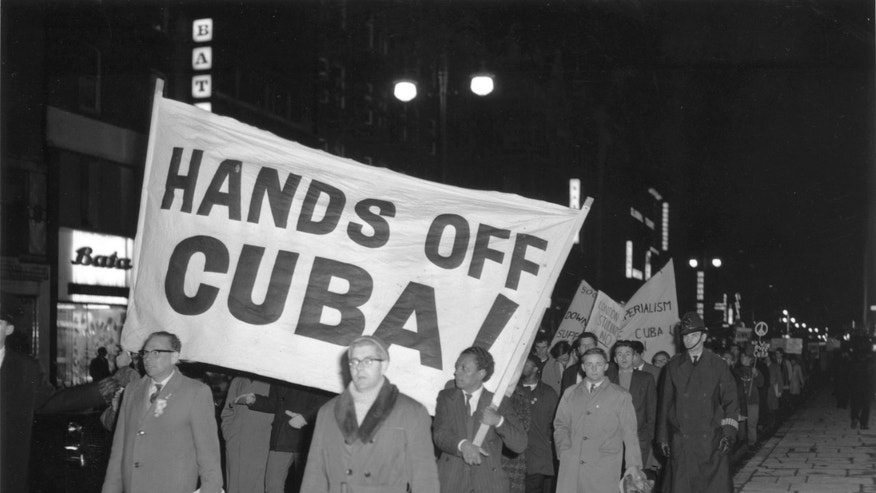 LONDON - OCTOBER 28, 1962:  (EDITORIAL USE ONLY)  (FILE PHOTO)  Members of the Campaign for Nuclear Disarmament (CND) march during a protest against the U.S.'s action over the Cuban missile crisis October 28, 1962 in London, United Kingdom. Former Russian and U.S. officials attending a conference commemorating the 40th anniversary of the missile crisis October 2002 in Cuba said that the world was closer to a nuclear conflict during the 1962 standoff between Cuba and the U.S., than governments were aware of.  (Photo by Getty Images)