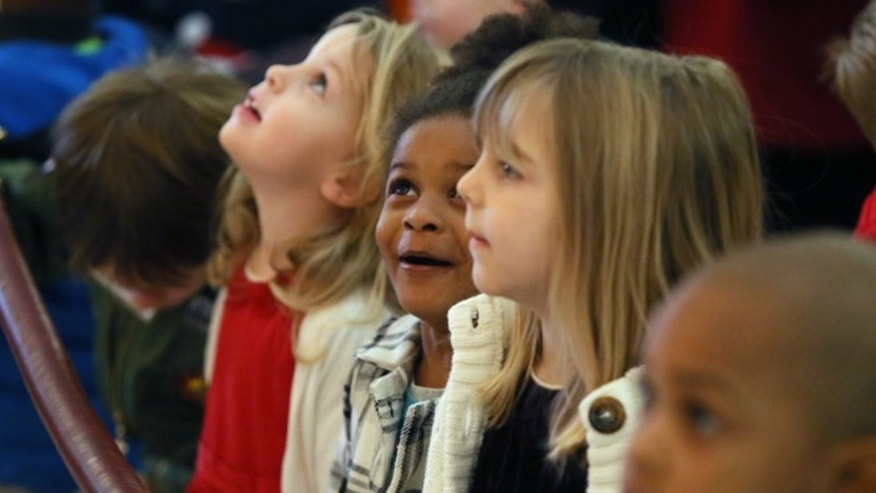 December 8, 2014: Children from the Child Development Center (CDC) of Central Presbyterian watch as the tree lights are turned on. Georgia Gov. Nathan Deal, first lady Sandra Deal and other state officials kick off the holiday season by taking part in the annual lighting of Christmas tree at the state Capitol in Atlanta.