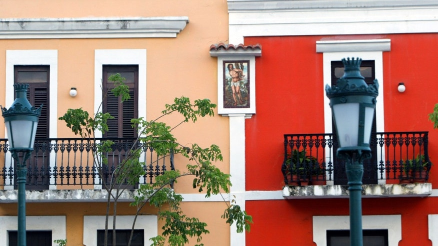 SAN JUAN, PUERTO RICO- APRIL 26: Colorful homes line the cobblestoned streets April 26, 2004 in Old San Juan, the original capital city of San Juan, Puerto Rico. The old city is a historic district of seven square blocks made up of ancient buildings and colonial homes, massive stone walls and vast fortifications, sunny parks and cobblestoned streets.  (Photo by Joe Raedle/Getty Images)