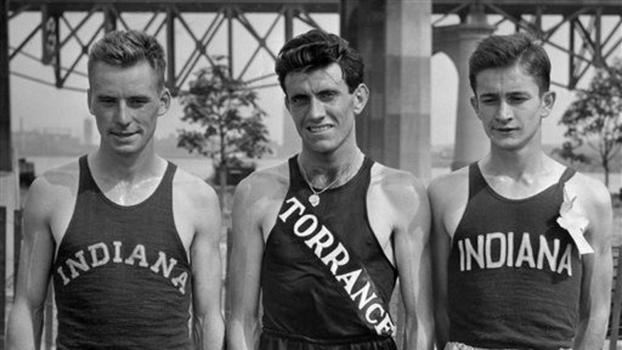 FILE - In a July 13, 1936 file photo, Don Lash of Indiana, left, Louis Zamperini of Los Angeles, center, and Thomas Deckard of Indiana, who will represent the United States in the Olympic Games in the 5,000 meter team, at the Olympic tryouts in New York. Zamperini, a U.S. Olympic distance runner and World War II veteran who survived 47 days on a raft in the Pacific after his bomber crashed, then endured two years in Japanese prison camps, died Wednesday, July 2, 2014, according to Universal Pictures studio spokesman Michael Moses. He was 97.  (AP Photo, File)
