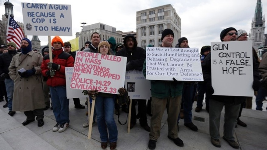 Jan. 23, 2013: Gun rights advocates demonstrate at the Pennsylvania Capital building in Harrisburg, Pa.
