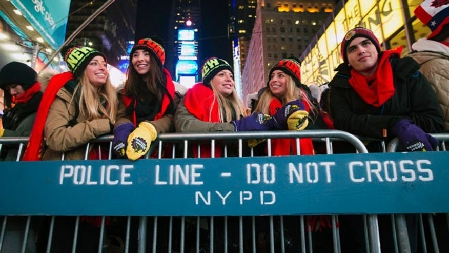 Dec. 31, 2014: Revelers stand at the barricades in Times Square during the New Year's Eve celebration in New York. (AP)