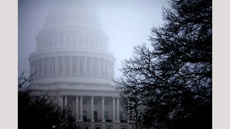 FILE - In this Dec. 10, 2012 file photo, fog obscures the Capitol dome on Capitol Hill in Washington.