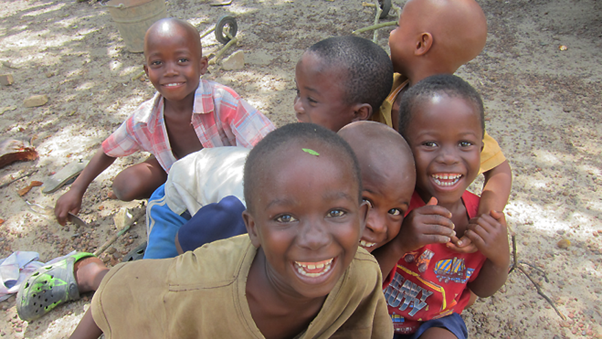 Liberian children captured on camera by CDC's Justin Williams in 2014.