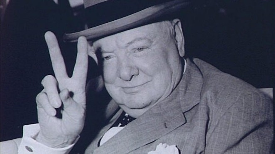 FILE -- May 25, 1954: Winston Churchill, British Prime Minister, gives V for Victory sign arriving in Washington, DC.