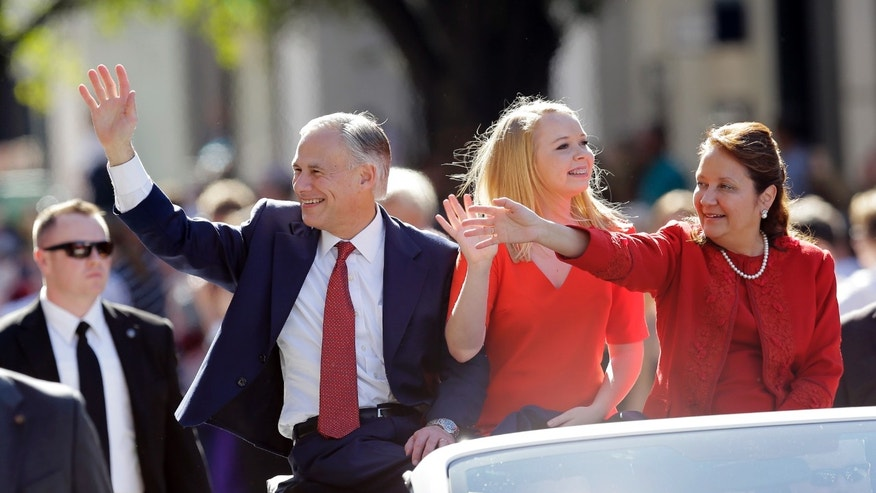 Texas Gov. Greg Abbott with daughter Audrey and wife, Cecilia on Tuesday, Jan. 20, 2015, in Austin, Texas.