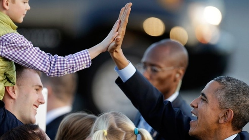 Feb. 12, 2015: President Obama high five's a boy upon his arrival at San Francisco International Airport in San Francisco.