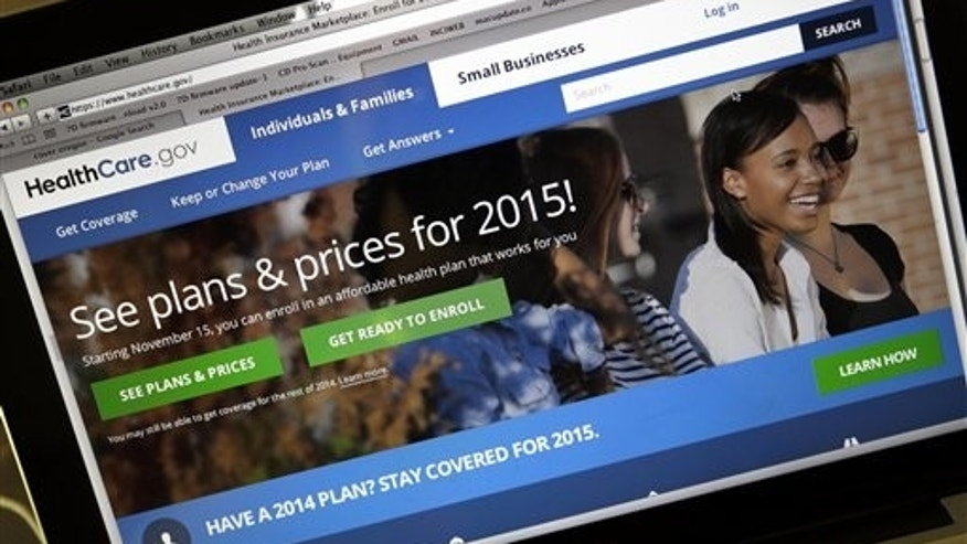 FILE - In this Nov. 12, 2014 file photo, the HealthCare.gov website, where people can buy health insurance, is seen on a laptop screen in Portland, Ore. (AP Photo/Don Ryan, File)